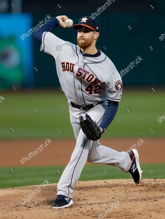 Houston Astros starting pitcher Collin McHugh winds up for a pitch against the Oakland Athletics during the first inning of the MLB baseball game between the Houston Astros and the Oakland Athletics at the Oakland Coliseum in Oakland, California, USA, 16 April 2019.