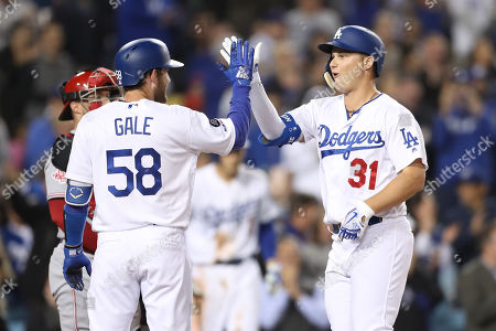 Los Angeles Dodgers left fielder Joc Pederson (31) celebrates his homer with Los Angeles Dodgers catcher Rocky Gale (58) during the game between the Cincinnati Reds and the Los Angeles Dodgers at Dodger Stadium in Los Angeles, CA. (Photo by Peter Joneleit)