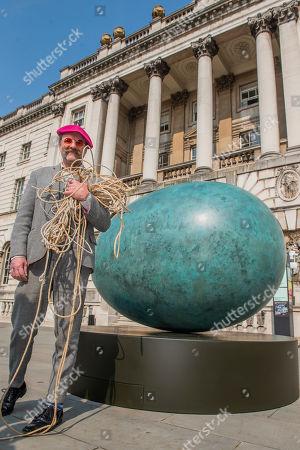 Gavin Turk with his sculpture