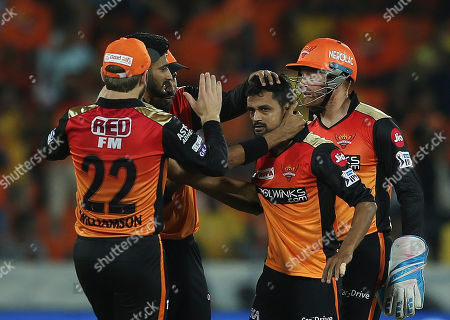 Sunrisers Hyderabad's Shahbaz Nadeem, second from left, celebrates with team after dismissal of Chennai Super King's Shane Watson during the VIVO IPL T20 cricket match in Hyderabad, India