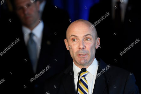 Stock Picture of DEA Assistant Administration John Martin speaks beside members of Appalachian Regional Prescription Opioid Strike Force, during a news conference, in Cincinnati