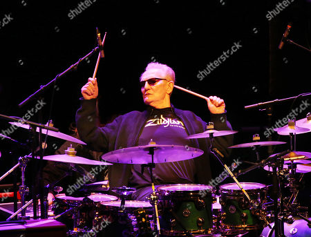 Stock Image of Ginger Baker playing the Drum Legends show