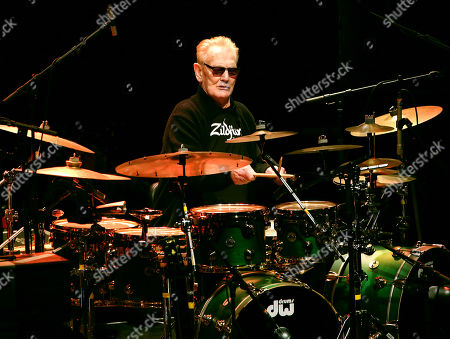 Stock Picture of Ginger Baker playing the Drum Legends show