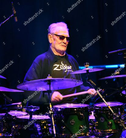 Stock Photo of Ginger Baker playing the Drum Legends show