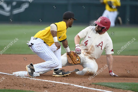 Arkansas baserunner Trevor Ezell slides sadly into third base in front of the tag of Arkansas Pine Bluff third baseman Justin Robinson during an NCAA college baseball game, in Fayetteville, Ark