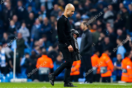 1558835ba288 Manchester City manager Pep Guardiola cuts a dejected figure after seeing  his team lose to Tottenham