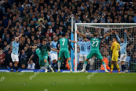 Tottenham's Fernando Llorente, second left, celebrates scoring his side's third goal as Manchester City players appeal for handball during the Champions League quarterfinal, second leg, soccer match between Manchester City and Tottenham Hotspur at the Etihad Stadium in Manchester, England