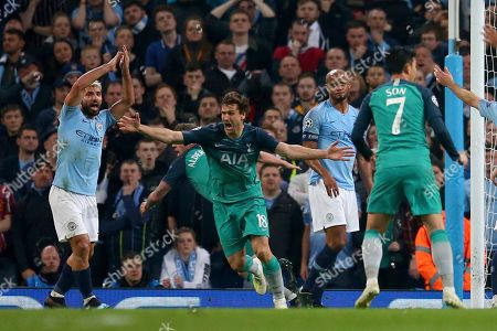 Tottenham's Fernando Llorente, second left, celebrates scoring his side's third goal as Manchester City's Sergio Aguero, left, appeals for handball watched by Manchester City's Vincent Kompany, second right, during the Champions League quarterfinal, second leg, soccer match between Manchester City and Tottenham Hotspur at the Etihad Stadium in Manchester, England