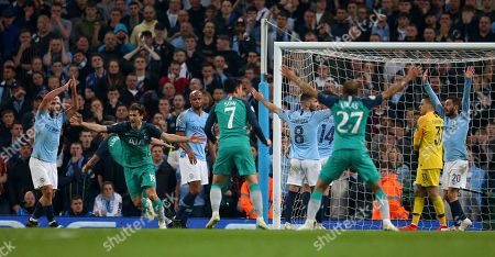 Tottenham's Fernando Llorente, second left, celebrates scoring his side's third goal as Manchester City's Sergio Aguero, left, appeals for handball watched by Manchester City's Vincent Kompany, third left, during the Champions League quarterfinal, second leg, soccer match between Manchester City and Tottenham Hotspur at the Etihad Stadium in Manchester, England