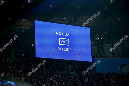 A big screen shows Manchester City's Raheem Sterling's goal was disallowed for offside against Manchester City's Sergio Aguero following a VAR review during the Champions League quarterfinal, second leg, soccer match between Manchester City and Tottenham Hotspur at the Etihad Stadium in Manchester, England