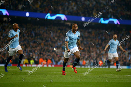 Manchester City's Raheem Sterling celebrates before his goal was disallowed for offside against Manchester City's Sergio Aguero following a VAR review during the Champions League quarterfinal, second leg, soccer match between Manchester City and Tottenham Hotspur at the Etihad Stadium in Manchester, England
