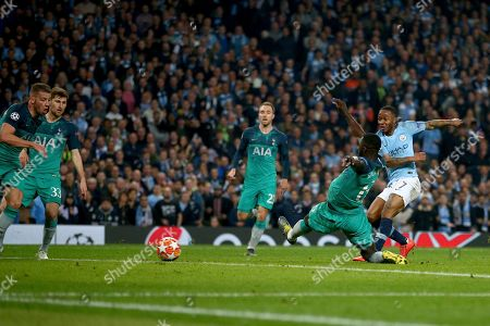Manchester City's Raheem Sterling, right, scores what would have been the winning goal for it to then be disallowed for offside against Manchester City's Sergio Aguero, not pictured, following a VAR review during the Champions League quarterfinal, second leg, soccer match between Manchester City and Tottenham Hotspur at the Etihad Stadium in Manchester, England
