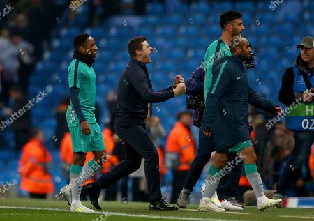 Tottenham coach Mauricio Pochettino, second left, celebrates after the Champions League quarterfinal, second leg, soccer match between Manchester City and Tottenham Hotspur at the Etihad Stadium in Manchester, England