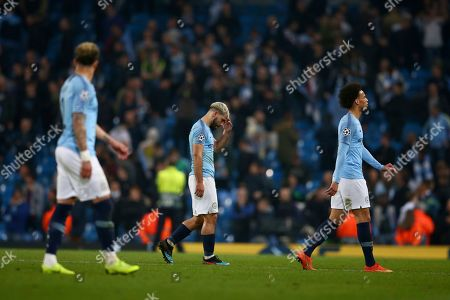 Manchester City's Sergio Aguero walks off the pitch after the final whistle for them to be defeated on away goals and knocked out after the Champions League quarterfinal, second leg, soccer match between Manchester City and Tottenham Hotspur at the Etihad Stadium in Manchester, England