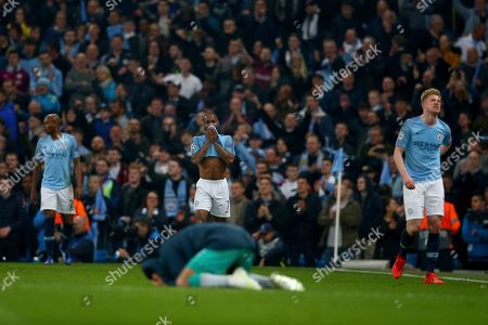 Manchester City's Raheem Sterling, center top, and Manchester City's Kevin De Bruyne, right, react after being defeated in the Champions League quarterfinal, second leg, soccer match between Manchester City and Tottenham Hotspur at the Etihad Stadium in Manchester, England