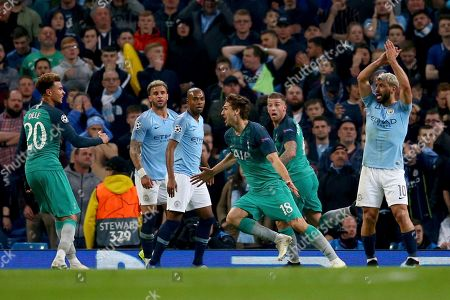 Tottenham's Fernando Llorente, fourth left, celebrates scoring his side's third goal as Manchester City's Sergio Aguero, right, appeals for handball watched by Manchester City's former Tottenham player Kyle Walker, second left, during the Champions League quarterfinal, second leg, soccer match between Manchester City and Tottenham Hotspur at the Etihad Stadium in Manchester, England
