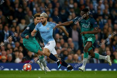 Manchester City's Sergio Aguero, center, competes for the ball with Tottenham's Dele Alli, left, and Tottenham's Victor Wanyama during the Champions League quarterfinal, second leg, soccer match between Manchester City and Tottenham Hotspur at the Etihad Stadium in Manchester, England