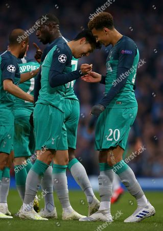 Tottenham's Son Heung-Min, center, celebrates scoring with Tottenham's Dele Alli, right, during the Champions League quarterfinal, second leg, soccer match between Manchester City and Tottenham Hotspur at the Etihad Stadium in Manchester, England