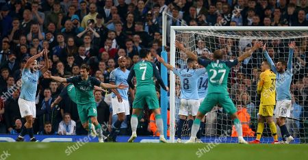 Stock Photo of Tottenham's Fernando Llorente, second left, celebrates scoring his side's third goal as Manchester City's Sergio Aguero, left, appeals for handball watched by Manchester City's Vincent Kompany, third left, during the Champions League quarterfinal, second leg, soccer match between Manchester City and Tottenham Hotspur at the Etihad Stadium in Manchester, England