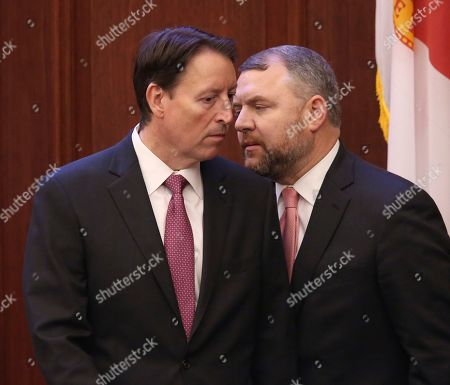 State Sen. Rob Bradley, R-Fleming Island, right, confers with Senate President Bill Galvano, R-Bradenton, during debate on a bill to allow teachers to be armed during a legislative session, in Tallahassee, Fla