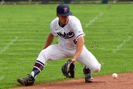 Pennsylvania's Josh Hood fields a hit during the sixth inning of an NCAA college baseball game at Meiklejohn Stadium, in Philadelphia. Penn defeated Princeton 15-9