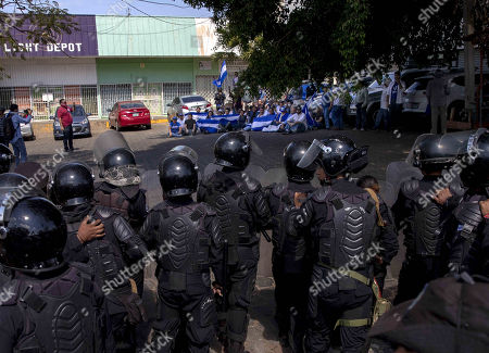 Members of Nicaraguan National Police face off with demonstrators during an opposition's anti-Government protest, in Managua, Nicaragua, 17 April 2019.