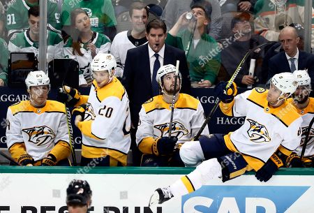 Mikael Granlund, Miikka Salomaki, Kyle Turris, Filip Forsberg, Peter Laviolette. Nashville Predators' Mikael Granlund (64), Miikka Salomaki (20), Filip Forsberg (9) and Kyle Turris (8) watch play as coach Peter Laviolette, center rear, gives instructions during the third period of Game 4 against the Dallas Stars in an NHL hockey first-round playoff series in Dallas