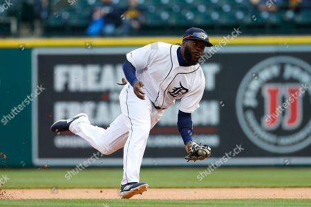 Detroit Tigers second baseman Josh Harrison fields a ground ball against the Pittsburgh Pirates in the first inning of a baseball game in Detroit