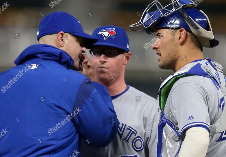 Trent Thornton, Peter Walker, Like Mailie. Toronto Blue Jays pitcher Trent Thornton, center, gets a visit at the mound from pitching coach Pete Walker, left, as catcher Luke Mailie talks in the first inning of a baseball game, in Minneapolis
