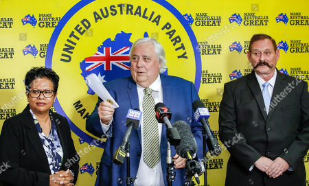 Federal Leader of the United Australia Party Clive Palmer (C), Yodie Batzke (L) and Martin Brewster (R) address the media during a press conference in Townsville, Australia, 18 April 2019. Palmer announced he is now entering the race for a seat in the Senate, alongside his other Queensland UAP candidates Martin Brewster and Yodie Batzke in the upcoming federal election, scheduled for 18 May 2019.
