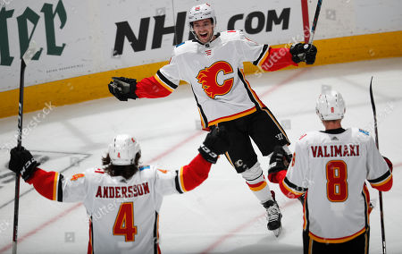 Derek Ryan, derek ryan. Calgary Flames center Derek Ryan, back, celebrates his goal with defensemen Rasmus Andersson, front left, and Juuso Valimaki, against the Colorado Avalanche in the third period of Game 4 of an NHL hockey playoff series, in Denver. The Avalanche won 3-2 in overtime