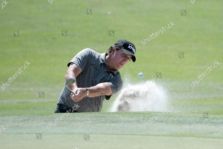 American track and field sprinter Noah Lyles trains at the National Training Center in Clermont, Florida. Phil Mickelson hits out of a bunker onto the second green during the first round of the Arnold Palmer Invitational golf tournament, in Orlando, Fla