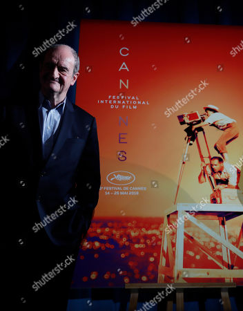 Festival president Pierre Lescure poses in front of the Cannes International Film Festival poster, which shows the late director Agnes Varda, for the upcoming 72nd edition during a press conference to announce this years line up in Paris, . The festival will run from May 14 to May 25, 2019