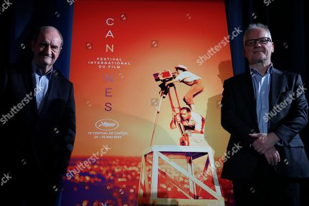 Thierry Fremaux, Pierre Lescure. Festival director Thierry Fremaux, right, and festival president Pierre Lescure pose in front of the Cannes International Film Festival poster, which shows the late director Agnes Varda, for the upcoming 72nd edition during a press conference to announce this years line up in Paris, . The festival will run from May 14 to May 25, 2019