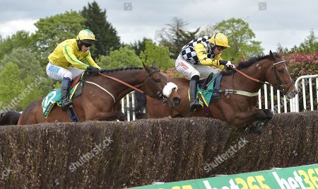 (R) Talkischeap (Wayne Hutchinson) takes the last before going on to win The bet365 Gold Cup Handicap Steeple Chase from The Young Master (Sam Waley-Cohen)..