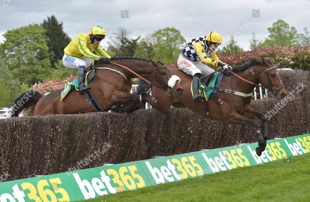 Stock Photo of (R) Talkischeap (Wayne Hutchinson) takes the last before going on to win The bet365 Gold Cup Handicap Steeple Chase from The Young Master (Sam Waley-Cohen)..