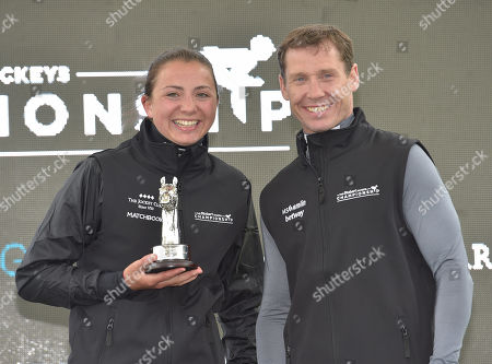 Bryony Frost, who was presented with The Stobart Champion Conditional Jockey award by Champion Jump jockey, Richard Johnson.