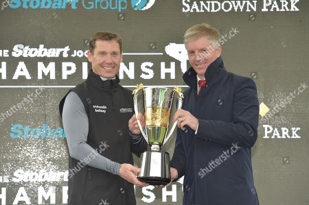 (L) Richard Johnson, who was presented with The Stobart Champion Jockey award by (R) Noel Fehily, former jockey.