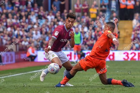22nd April 2019 , Villa Park, Birmingham, England ; Sky Bet Championship, Aston Villa vs Millwall : Keinan Davis (17) of Aston Villa skips past James Meredith (03) of Millwall 