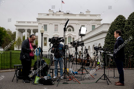 NBC reporter Peter Alexander stands outside of the West Wing of the White House, in Washington