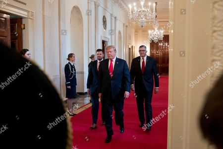 Donald Trump, Michael Linnington, Jose Ramos. President Donald Trump, center, accompanied by Wounded Warrior Project CEO Michael Linnington, right, and Jose Ramos, left, arrives for a Wounded Warrior Project Soldier Ride event in the East Room of the White House, in Washington