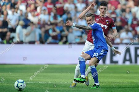 Stock Image of Declan Rice of West Ham United and James Maddison of Leicester City in action during the Premier League match between West Ham United and  Leicester City at the London Stadium in London, UK - 20th April 2019