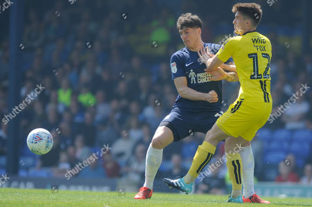 Rob Kieran of Southend United and Ben Fox of Burton Albion in action during the Sky Bet One match between Southend United and Burton Albion at Roots Hall in Southend, UK. 22nd April 2019.