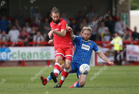 Stock Photo of Crawley's Joe McNerney challenges Notts County's Craig Mackail-Smith during the EFL 2 match between Crawley Town and Notts County at the Peoples Pension Stadium in Crawley. 22 April 2019