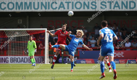 Stock Image of Crawley's Joe McNerney challenges Notts County's Craig Mackail-Smith during the EFL 2 match between Crawley Town and Notts County at the Peoples Pension Stadium in Crawley. 22 April 2019