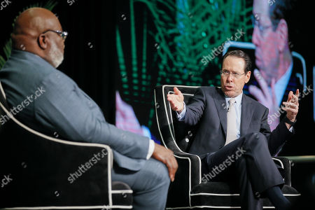 Bishop T.D. Jakes, left, and AT&T CEO Randall Stephenson, right, hold a fireside chat about the pilot employment program in partnership with the Texas Offenders Reentry Initiative (T.O.R.I.) on in Dallas