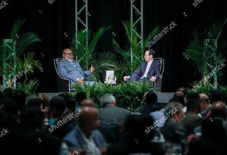 Stock Image of Randall Stephenson, Bishop T.D. Jakes. Bishop T.D. Jakes, left, and AT&T CEO Randall Stephenson, right, hold a fireside chat about the pilot employment program in partnership with the Texas Offenders Reentry Initiative (T.O.R.I.) on in Dallas