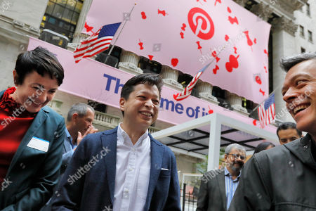 Pinterest co-founder & CEO Ben Silbermann, center, gathers with company employees outside the New York Stock Exchange, before the Pinterest IPO