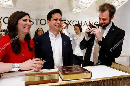 Pinterest co-founder and chief product officer Evan Sharp, right, photographs fellow co-founder & CEO Ben Silbermann, and NYSE President Stacey Cunningham on the New York Stock Exchange trading floor, before the company's IPO