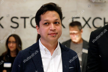 Pinterest co-founder & CEO Ben Silbermann, left, is photographed on the New York Stock Exchange trading floor, before the company's IPO